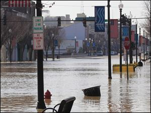 Part of North Main Street in Findlay, Ohio, is flooded, Tuesday.