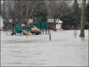 The play area in a park on Brookside Drive in Findlay is under water.