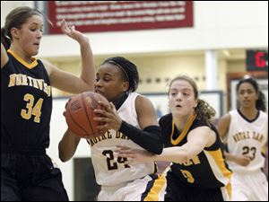 Sylvania Northview players Katelynn McCoy (34) and Miriam Justinger (30) try to stop a driving Cat Wells (24) of Notre Dame.
