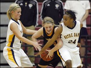 Wildcats player Mary Grace Fitzgerald (50) battles for the ball with Eagles teammates Demy Whitaker (12) and Cat Wells (24).
