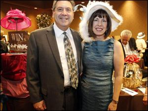 Mark Laktzian, left, and JoAnn Curran at the Maumee Rotary Auction.