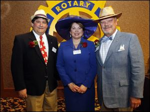 Event chair Mark Williams, left, Rotary President Sue McCloskey, center, and Greg Fish, chairman of the Maumee Rotary Service Foundation.