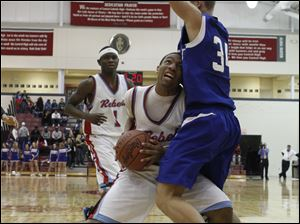 Blue Devils player Jeremy Weemes (34) tries to stop Rebels player Mookie Mustaffa (24) during the third quarter.