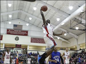 Bowsher player Robert Davis (1) breaks away for a dunk against Springfield.