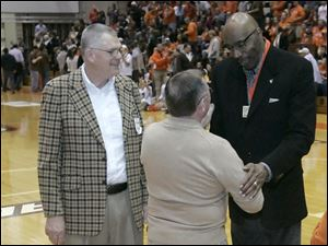 BGSU alumni Herb Westfall, left, and former BGSU basketball player Bill Reynolds, center, greet Nate Thurmond.