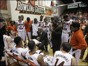 BGSU coach Louis Orr discusses strategy with his team during a timeout.