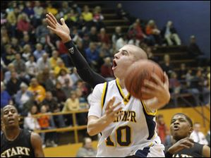 Whitmer's Ben Syroka takes a shot at the basket ahead of Start's Demond Crisp (12).