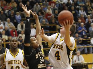 Start's James Grays (34) defends Whitmer's Luke Hickey (4).