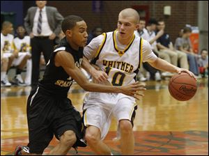 Whitmer's Ben Syroka tries to drive around Start's Elijah Smith.