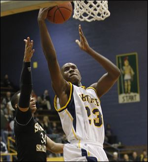 Whitmer's Nigel Hayes goes high to grab a rebound away from Start's James Grays.