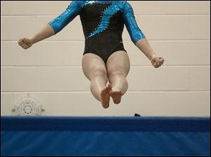 Alexa Settlemire of Findlay does a flip during her Vault routine.