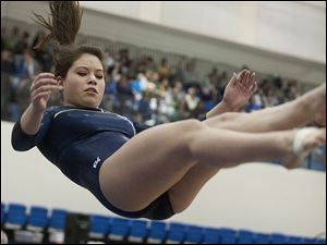 Kyra Schell of Toledo Notre Dame is airborne as she dismounts at the end of her Balance Beam routine.