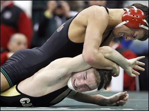 Tyler Hackworth of Oak Harbor defeats Robby Reed of Canfield in the Division II 125 pound championship match.