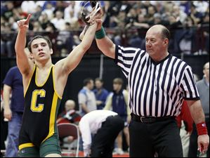 Angelo Amenta of Clay celebrates winning the Division I 130 pound championship match.