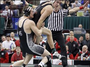 Konnor Witt of Oak Harbor can't escape the grip of Isaac Jordan of St. Paris Graham in the 171 pound Division II championship match. Jordan won.