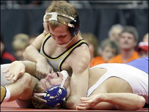 Nick Goebel of Elmwood is pinned by Tyler Heminger of Galion Northmor during 119 pound Division III championship match.