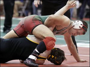 Tony Martin of Toledo Central Catholic defeats Austin Jones of Dresden Tri-Valley  during the  Division II 160 pound championship match for third place.
