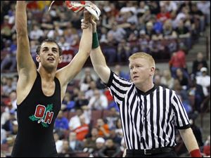 Oak Harbor's Tyler Hackworth celebrates his win over Robby Reed in the 125 pound championship.