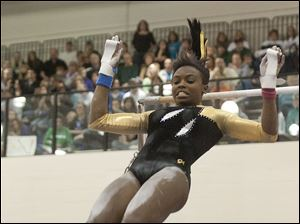 Chelsea Williams of Perrysburg prepares to land after completing her Uneven Parallel Bars routine.