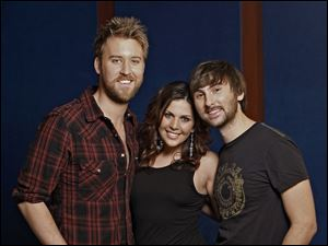 Country group Lady Antebellum -- Charles Kelley, left, Hillary Scott and Dave Haywood -- will perform July 15 at the Toledo Zoo.