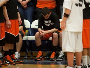 Fennville basketball player listens during the national anthem before their game state high school tournament against Lawrence Monday.