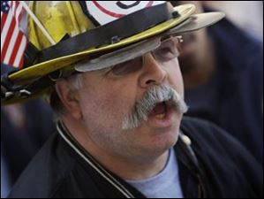Westerville firefighter Tom Ullom, 55, participates in a protest against SB-5 outside the Statehouse during the State of the State speech by Gov. John Kasich.