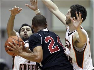 BGSU guards Jordon Crawford (1) and James Erger (12) defend against Northern Illinois guard Jeremy Landers (24).