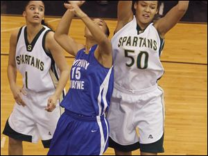 Start's Azia Bishop (50) snags a rebound from Anthony Wayne's Aisha Potts-Tyre (15). Bishop would give the Spartans a triple-double effort with 11 points, 10 rebounds, and 12 blocked shots.