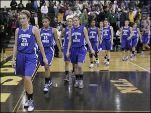 Anthony Wayne's Emma Ricketts (25) leads her team off the floor after their 53-23 regional semifinal loss to Start.