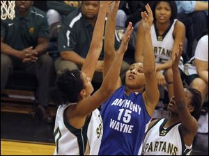 Spartans player Azia Bishop (50) blocks the shot of Generals player Aisha Potts-Tyre (15).