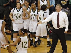 Start head coach Bob Brown, right, greets his team during a time-out against Anthony Wayne during a regional semifinal.