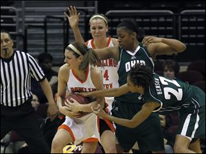 BGSU's Chrissy Steffen does her best to keep the ball away from Ohio's Tenishia Benson.