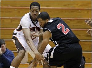 Bowling Green State University forward Cameron Black (35) battles against Northern Illinois guard DeMarcus Grady (2) for a loose ball.