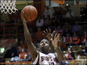 Bowling Green State University guard Dee Brown (22) goes to the net against Northern Illinois guard Antone Christian (2).