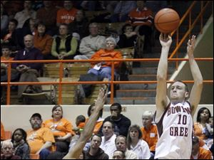 Bowling Green forward Scott Thomas (10) hits a three point basket against Northern Illinois guard DeMarcus Grady (2). Thomas would give the Falcons 12 points and a career-high nine assists.