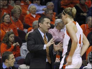 BGSU head coach Curt Miller confers with Maggie Hennegan during the game's second half.