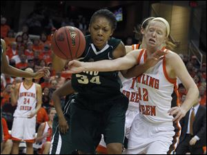 Ohio's Kamille Buckner and BG's Danielle Havel chase a loose ball down the court.