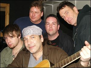 Clockwise from left: Chris Shutters, Greg Robie, Ev Harris, Brian Albright, and Mark Mikel.