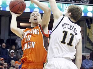 BGSU's Scott Thomas takes a shot against Western Michigan's Nate Hutcheson.