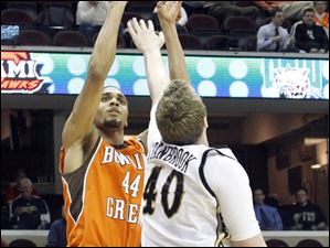BGSU's Mike Dabney shoots over the had of Western Michigan's Matt Stainbrook.