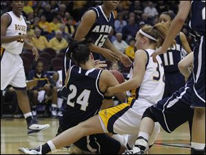 Akron's Kara Murphy (24) and UT's Melissa Goodall (32) fight for the ball.