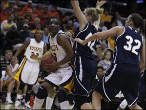 UT's Lecretia Smith (3). looks to pass past Akron's Sina King (42).