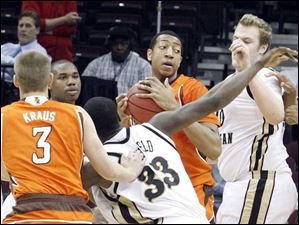 The Falcons' Cameron Black pulls down the rebound under Western Michigan's basket.