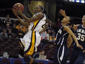 Toledo's Andola Dortch (22) drives to the basket past Akron's Natasha Williams (11).