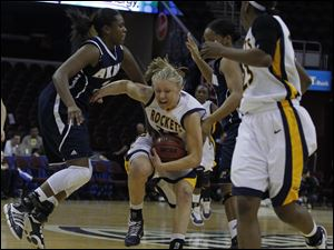 Akron's Jasmine Mushington (23) guards UT's Haylie Linn (35).