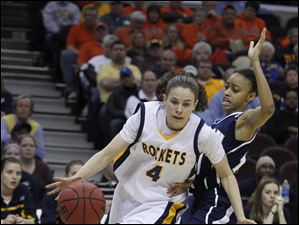 Toledo's Naama Shafir (4) drives around Akron's Natasha Williams (11).