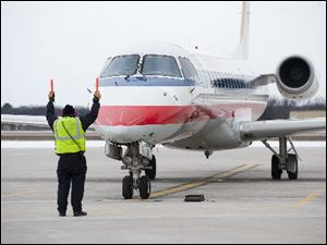 An American Eagle plane arrives at the Cherry Capital Airport, in Traverse City, Mich.