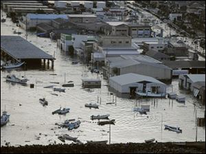 A port is submerged after a tsunami spawned by a powerful earthquake in Oarai town, Ibaraki prefecture (state), Japan, Friday, March 11, 2011.