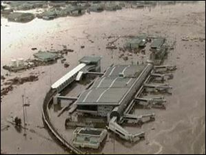 In this video image taken from Japan's NHK TV, water surrounds the airport building at Sendai Airport, Miyagi Prefecture, Japan Friday March 11, 2011 following a massive earth quake.
