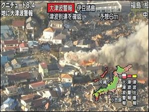 In this image taken from NHK television, smokes rise from houses in Soma, Fukushima, northern Japan Friday, March 11, 2011 after an earthquake.